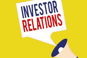 Text sign showing Investor Relations. Conceptual photo management responsibility that integrates finance Megaphone and Blank Bordered Square Speech Bubble Public Announcement.