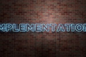 IMPLEMENTATION – fluorescent Neon tube Sign on brickwork