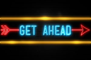 Get Ahead  – fluorescent Neon Sign on brickwall Front view